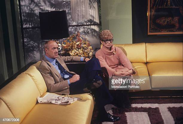 'Italian actor and TV host Raimondo Vianello sitting on a sofa beside his wife and Italian actress Sandra Mondaini They present together the TV...