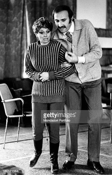 Italian actor and TV presenter Pippo Baudo standing arm in arm with Italian actress Sandra Mondaini during the rehearsals of the theatrical comedy...