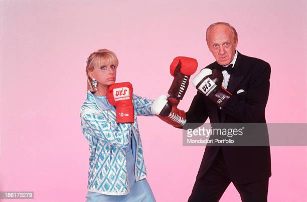 Italian actor and TV presenter Raimondo Vianello and his wife Italian actress and TV presenter Sandra Mondaini wearing boxing gloves and faking a...