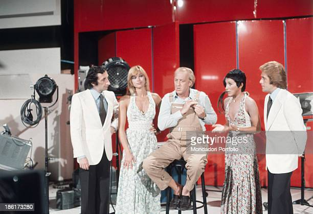 Italian actor and TV presenter Raimondo Vianello in the TV show Tante scuse sitting among the members of the Italian music band Ricchi e Poveri...