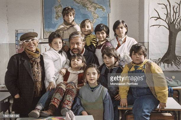Italian actor and writer Paolo Villaggio posing beside Italian director Lina Wertmuller and the children playing in the film Ciao Professore 1992
