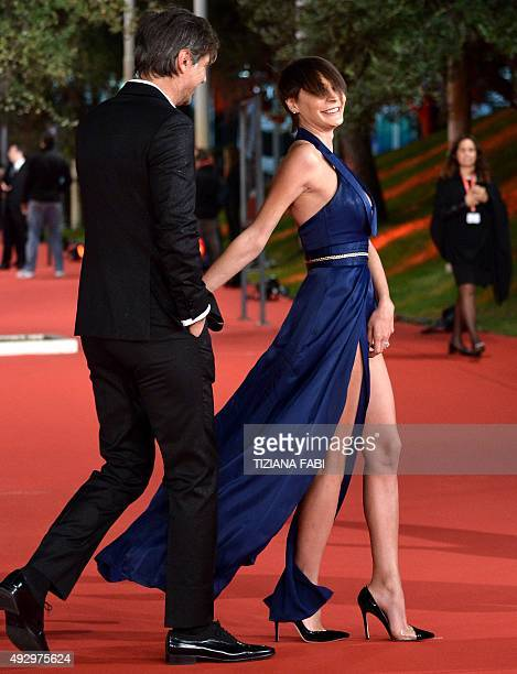 Italian actor Beppe Convertini and Italian actress Samantha Capitone walk the red carpet during the Rome Film Festival on October 16 2015 in Rome AFP...