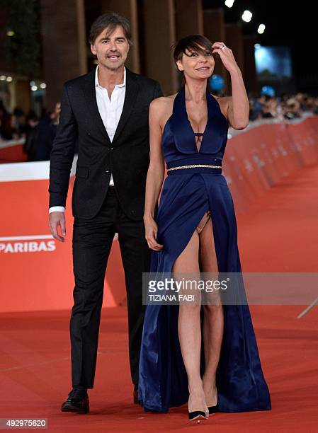 Italian actor Beppe Convertini poses with Italian actress Samantha Capitone on the red carpet during the Rome Film Festival on October 16 2015 in...