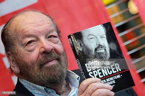 Italian actor Bud Spencer poses with a copy of his autobiography at Hugendubel bookstore on November 30 2011 in Munich Germany