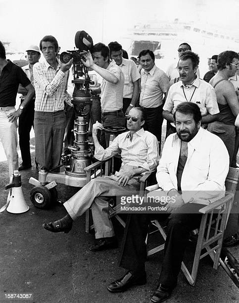 Italian actor Bud Spencer sitting beside the Italian director Steno on the set of the film The Knock Out Cop Naples 1973