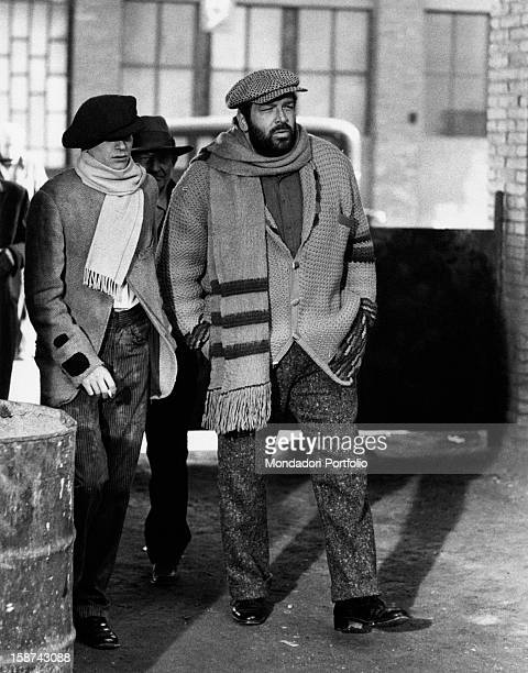 Italian actor Bud Spencer walking with two extras on the set of the film Even Angels Eat Beans Rome 1973