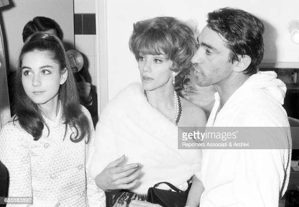 Italian actor comedian and TV host Walter Chiari wearing a bathrobe in his dressing room after a theatre show and standing beside the young...