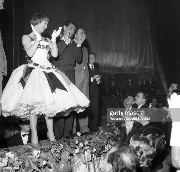 Italian actor comedian and TV host Walter Chiari with Italian actress Delia Scala clapping hands from the forestage of the Sistina Theatre for the...