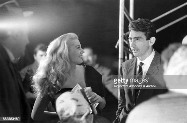 Italian actor comedian and TV host Walter Chiari with Swedishborn Italian actress Anita Ekberg during a break on the set of 'La dolce vita' Rome 1959