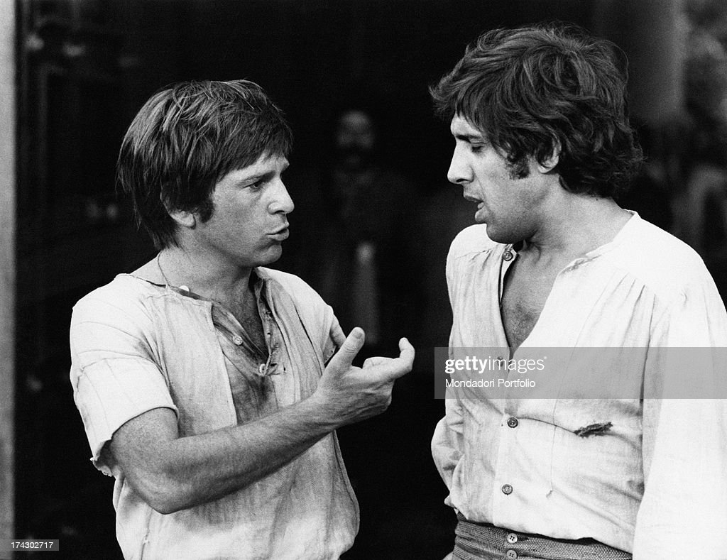 Italian actor Enzo Cerusico in stage costume gesticulates while he is talking with another Italian actor Adriano Celentano on the set of the movie...