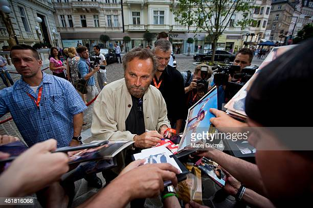 Italian actor Franco Nero signs autographs for fans at the 49th Karlovy Vary International Film Festival on July 6 2014 in Karlovy Vary Czech Republic