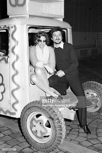 Italian actor Gigi Proietti and Italian singer Ornella Vanoni sitting in a van during the shooting of the TV show Fatti e fattacci 1975