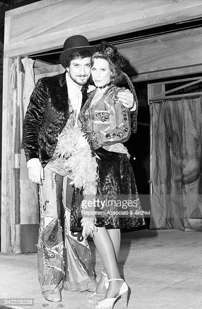 Italian actor Gigi Proietti next to Italian singer Ornella Vanoni during the shooting of TV show Fatti e fattacci 1975