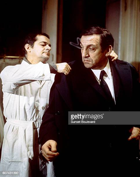 Italian actor Lino Ventura and Italianborn French singer and actor Serge Reggiani on the set of L'Armée des Ombres based on the novel by Joseph...