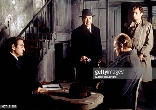Italian actor Lino Ventura French actors Paul Meurisse Christian Barbier and Claude Mann on the set of L'Armée des Ombres based on the novel by...