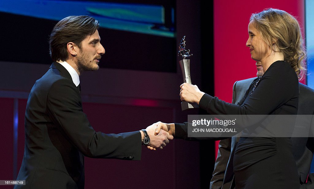 Italian actor Luca Marinelli receives his Shooting Star award from French actress Julie Delpy during the 63rd Berlinale Film Festival in Berlin February 11, 2013. The Shooting Star awards reward Europe's best young promising actors.