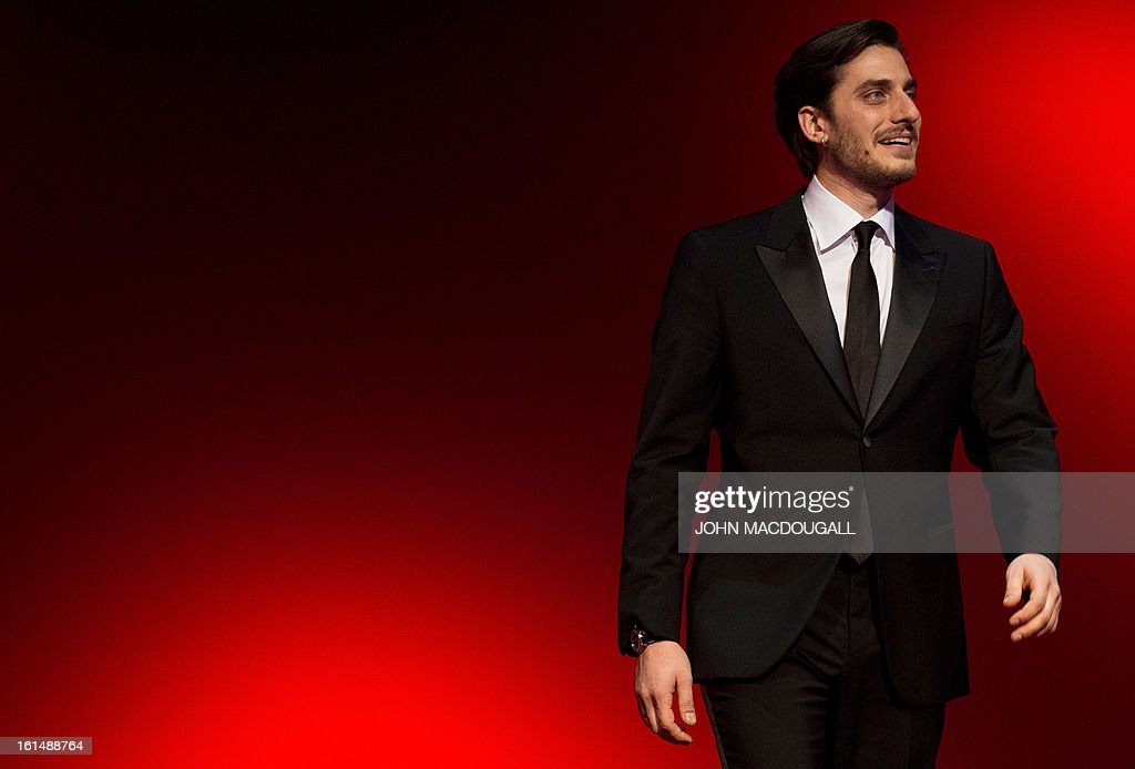 Italian actor Luca Marinelli steps on stage to receive his Shooting Star award during the 63rd Berlinale Film Festival in Berlin February 11, 2013. The Shooting Star awards reward Europe's best young promising actors. AFP PHOTO / JOHN MACDOUGALL