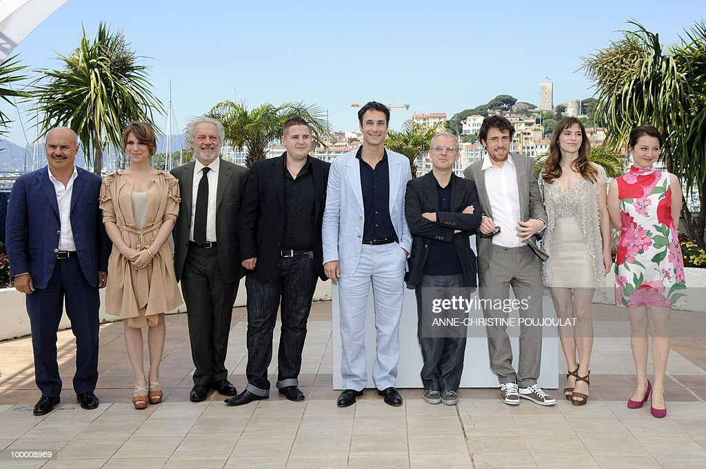 Italian actor Luca Zingaretti, Italian actress Isabella Ragonese, Italian actor Giorgio Colangeli, Italian actor Marius Ignat, Italian actor Raoul Bova, Italian director Daniele Luchetti, Italian actor Elio Germano, Italian actress Stefania Montorsi and Italian actress Alina Berzenteanu pose during the photocall of 'La Nostra Vita' (Our Life) presented in competition at the 63rd Cannes Film Festival on May 20, 2010 in Cannes.