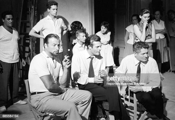 Italian actor Marcello Mastroianni and French actor Alain Cuny with other collegues during a break on the set of La dolce vita Rome 1959