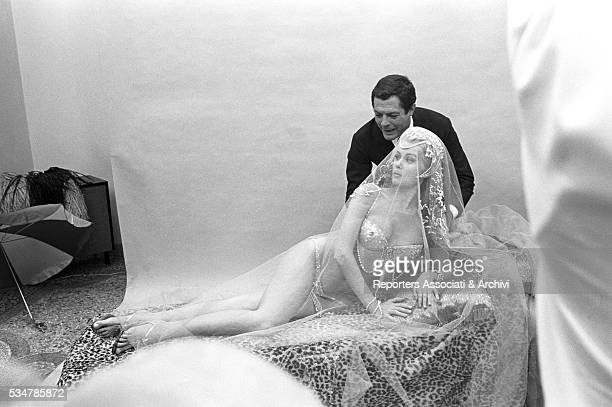 Italian actor Marcello Mastroianni beside American actress Pamela Tiffin dressed as an odalisque on the set of the film The Man the Woman and the...