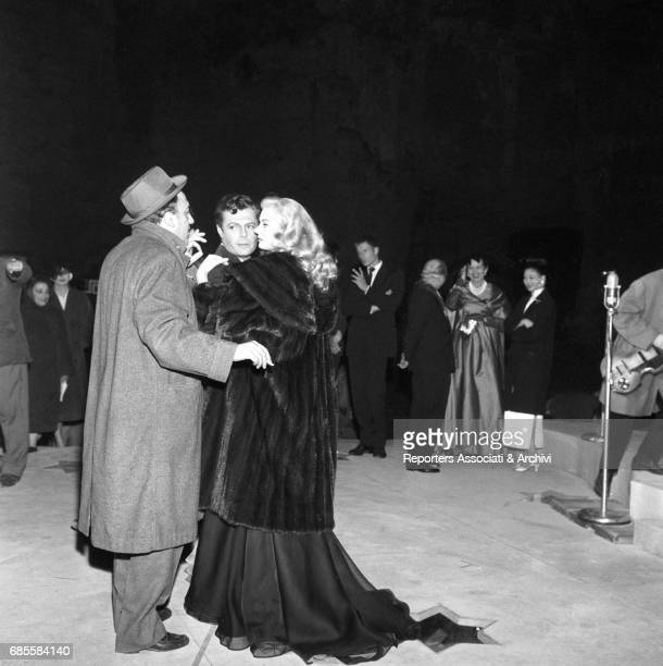 Italian actor Marcello Mastroianni dancing with Swedishborn Italian actress Anita Ekberg during a reharsal on the set of 'La dolce vita' under the...