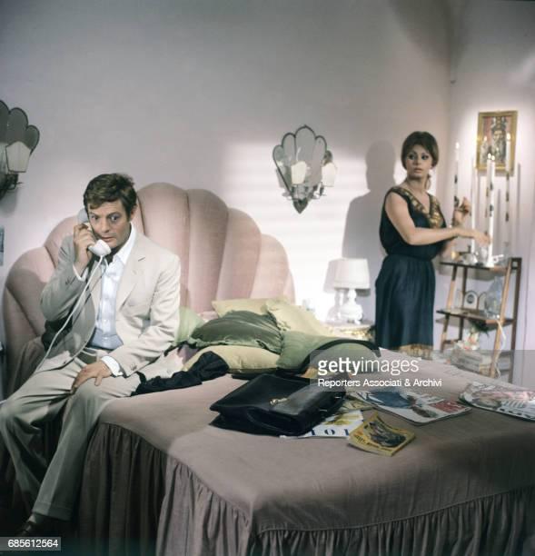 Italian actor Marcello Mastroianni having a phone call under the gaze of Italian actress Sophia Loren in Yesterday Today Tomorrow episode 'Mara' 1963
