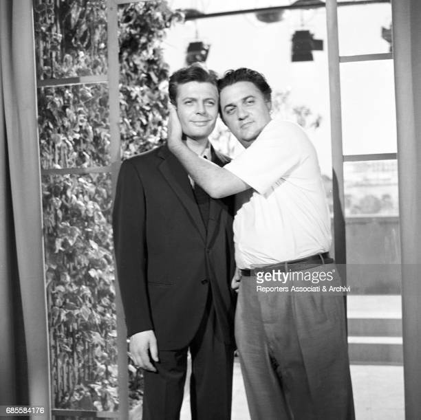 Italian actor Marcello Mastroianni hugging Italian director Federico Fellini during a break on the set of La dolce vita Rome 1959