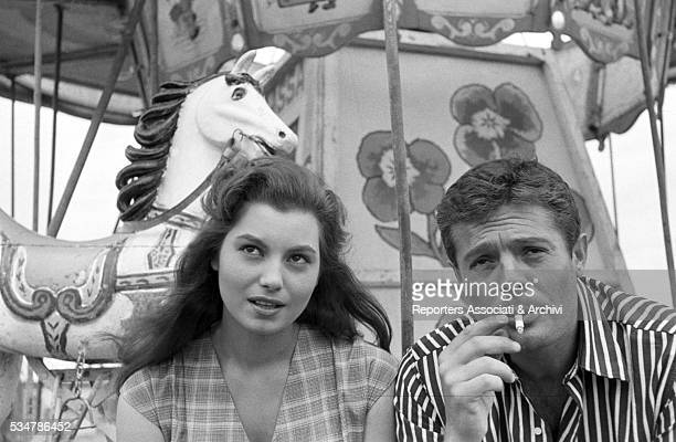 Italian actor Marcello Mastroianni smoking beside Italian actress Rosanna Schiaffino in the film Piece of the Sky 1957