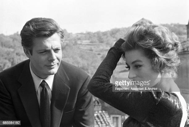 Italian actor Marcello Mastroianni with French actress Anouk Aim'e during a break on the set of La dolce vita Rome 1959