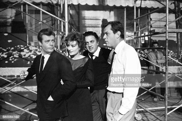 Italian actor Marcello Mastroianni with French actress Anouk Aim'e and Italian director Federico Fellini during a break on the set of La dolce vita...