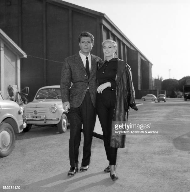 Italian actor Marcello Mastroianni with Swedishborn Italian actress Anita Ekberg strolling arm in arm through the alleys of Cinecitt… during a break...