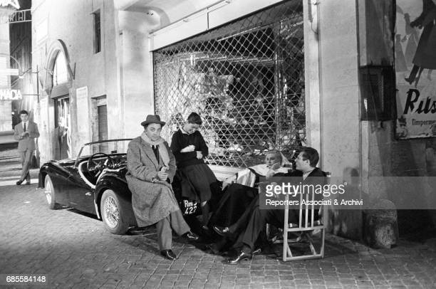 Italian actor Marcello Mastroianni with Swedishborn Italian actress Anita Ekberg Italian director Federico Fellini and a woman with a cat on her lap...