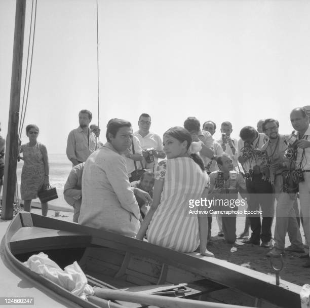 Italian actor Marcello Mastroianni with the swedish actress Anna Karina while sitting on a boat surrounded by photographers in Venice for the Movie...