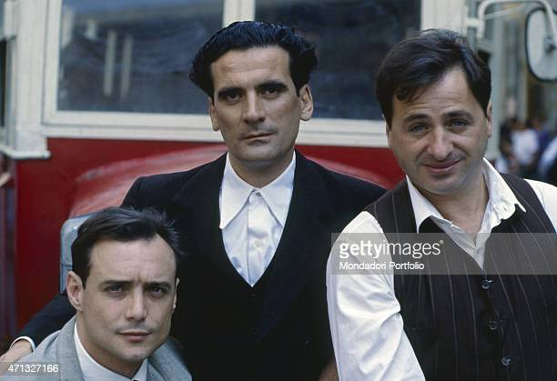 Italian actor Massimo Bonetti Italian actor and director Massimo Troisi and Italian actor and scenarist Marco Messeri posing on the set of the film...