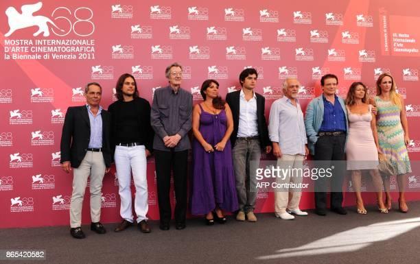 Italian actor Massimo Ranieri actress Amanda Sandrelli and the cast of 'Scossa' pose during the photocall at the 68th Venice Film Festival on...