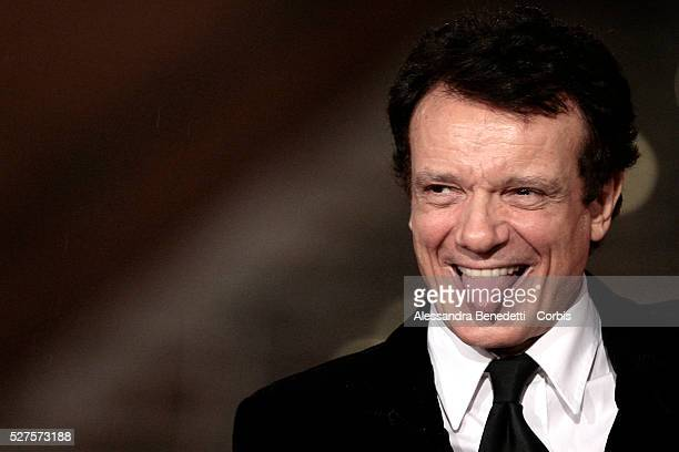 Italian actor Massimo Ranieri arrives to attend the closing ceremony of the third edition of the Rome International Film Festival