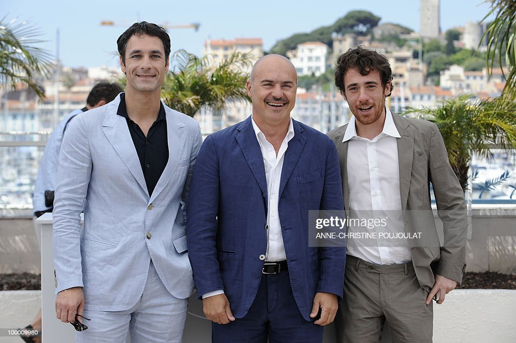 Italian actor Raoul Bova (L), Italian actor Luca Zingaretti (C) and Italian actor Elio Germano pose during the photocall of 'La Nostra Vita' (Our Life) presented in competition at the 63rd Cannes Film Festival on May 20, 2010 in Cannes.