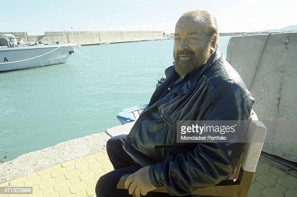 Italian actor scriptwriter and film producer Bud Spencer sitting near the harbour Crotone 2001