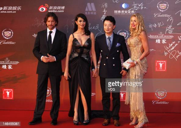 Italian actor Sergio Assisi actress Maria Grazia Cucinotta and Chinese actor Huang Haibo arrive at the red carpet during the opening ceremony for the...