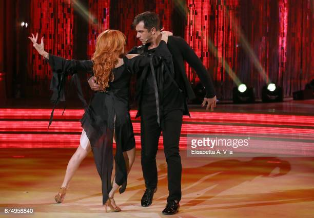 Italian actor Simone Montedoro and his dance partner Alessandra Tripoli perform on the Italian TV show 'Ballando Con Le Stelle' at Auditorium Rai on...