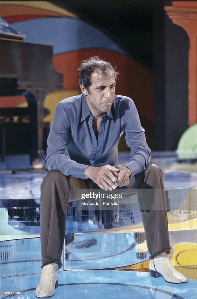 Italian actor singer and songwriter Adriano Celentano sitting on a stage 1979