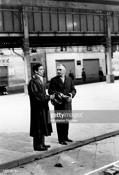 Italian actor singer and songwriter Enzo Jannacci with Italian director Mario monicelli on the set of the episode The Refrigerator from the film The...