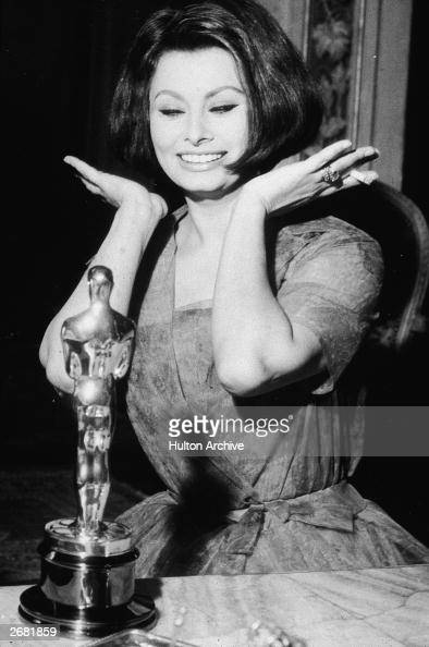 Italian actor Sophia Loren reacts after winning her Best Actress Oscar for the film 'La Ciociara' after the Academy Awards April 1962