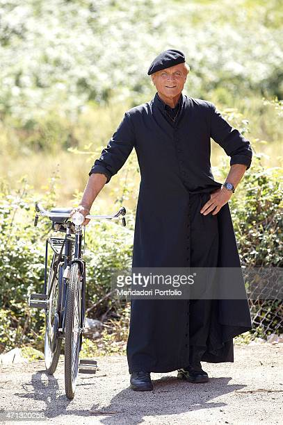 Italian actor Terence Hill as the parish priest of the village in Umbria posing with his bicycle in a photo shooting on the set of the TV fiction...