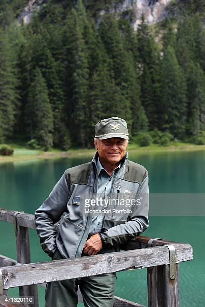 Italian actor Terence Hill as the State Forestry Corps Chief inspector Pietro leaning against a wooden fence in a photo shooting on the set of the TV...