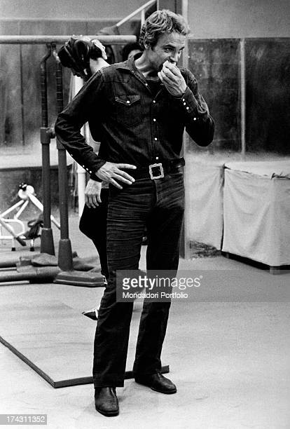Italian actor Terence Hill eating an apple on the set of the film Watch Out We're Mad Rome 1974