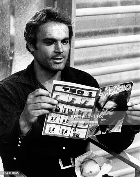 Italian actor Terence Hill reading the magazine Il Monello with Italian actor Bud Spencer on the cover on the set of the film Watch Out We're Mad...