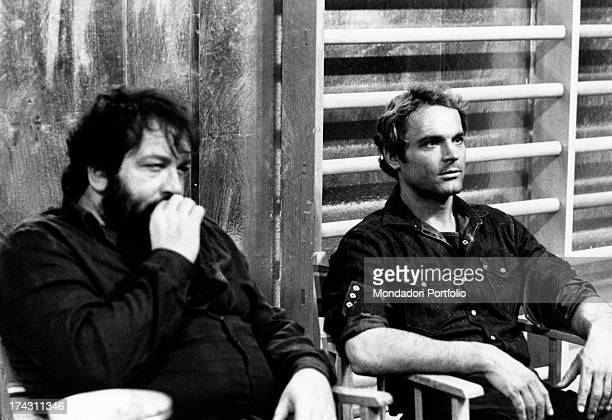 Italian actor Terence Hill sitting beside Italian actor Bud Spencer in the film Watch Out We're Mad Rome 1974