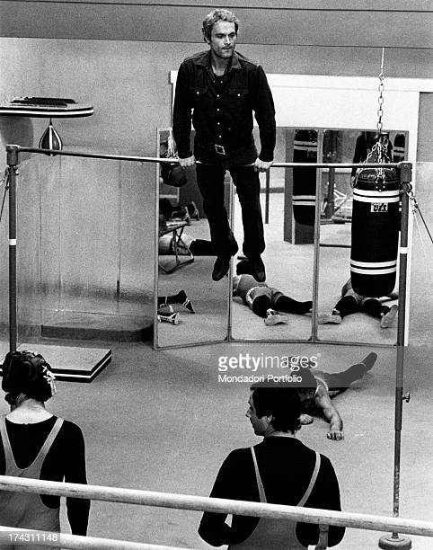 Italian actor Terence Hill training on the bar on the set of the film Watch Out We're Mad Rome 1974