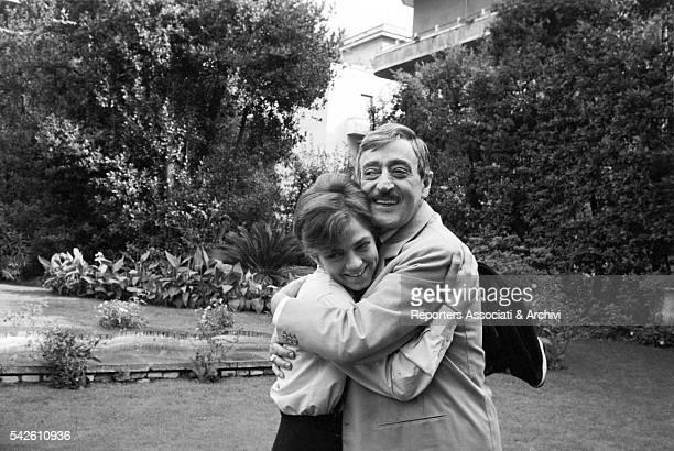 Italian actor Tot˜ and Italian actress and singer Rita Pavone hugging in Rita la figlia americana 1965
